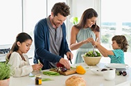 A family prepares a healthy meal.